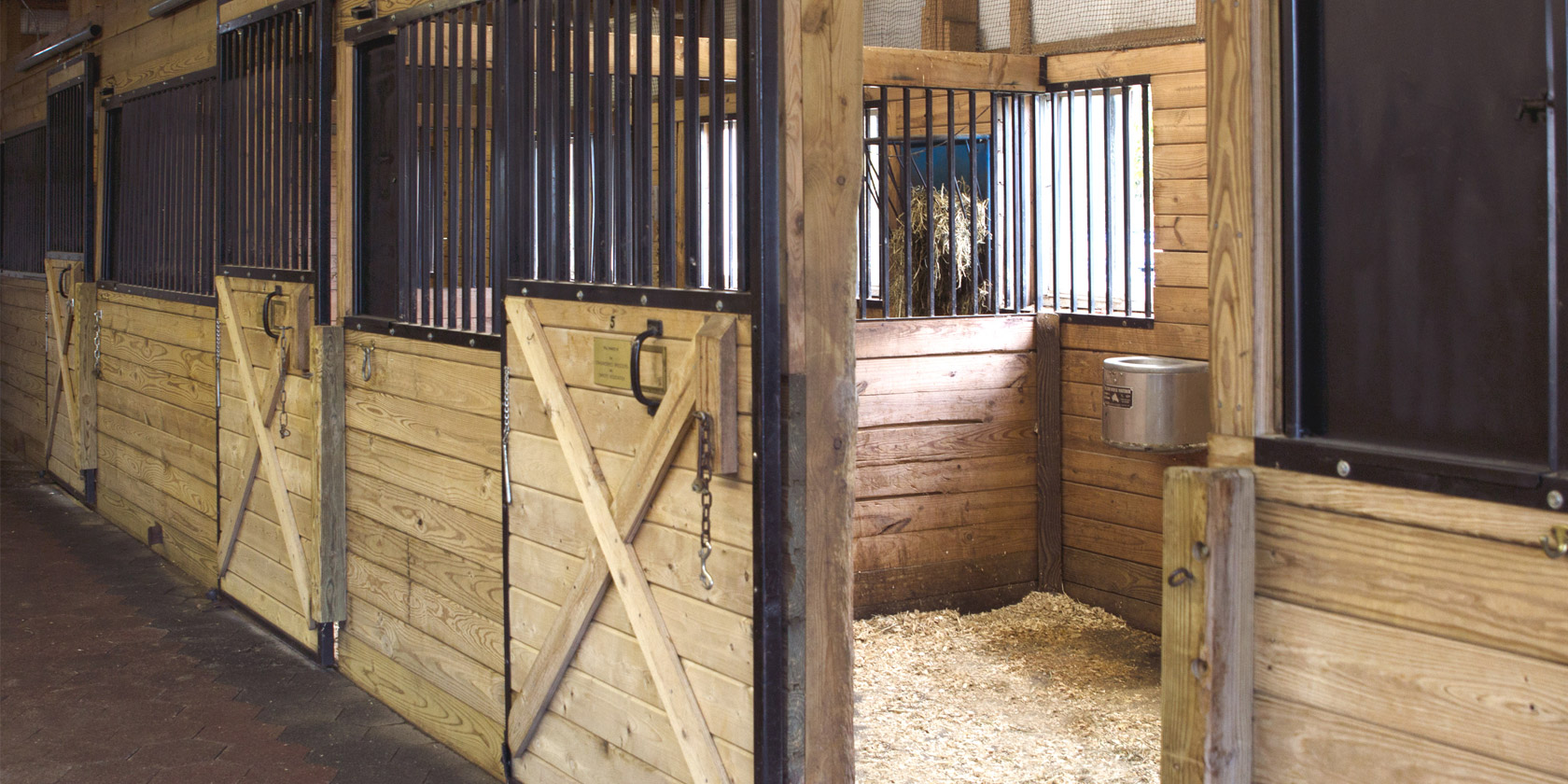 Red Barn These 14 stalls include automatic waterers and hay racks. Funding for the stalls was provided by donations from the horse industry.